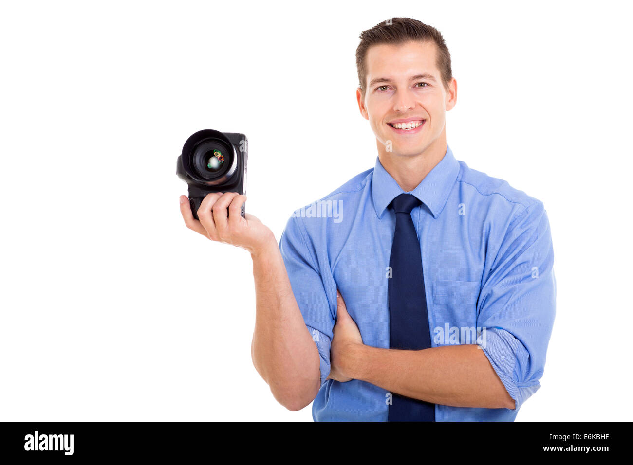 portrait of good looking male photographer holding camera - Stock Image