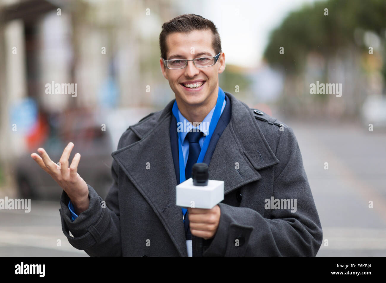 cheerful weather reporter in live broadcast - Stock Image