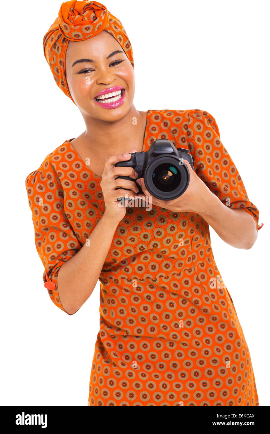 pretty young African woman holding a digital SLR camera on white background - Stock Image