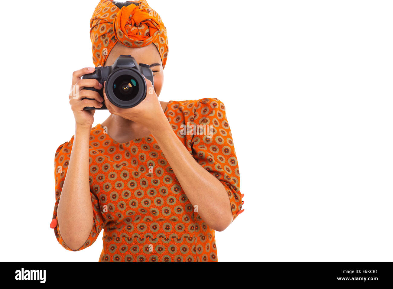 African woman using a camera isolated on white background - Stock Image