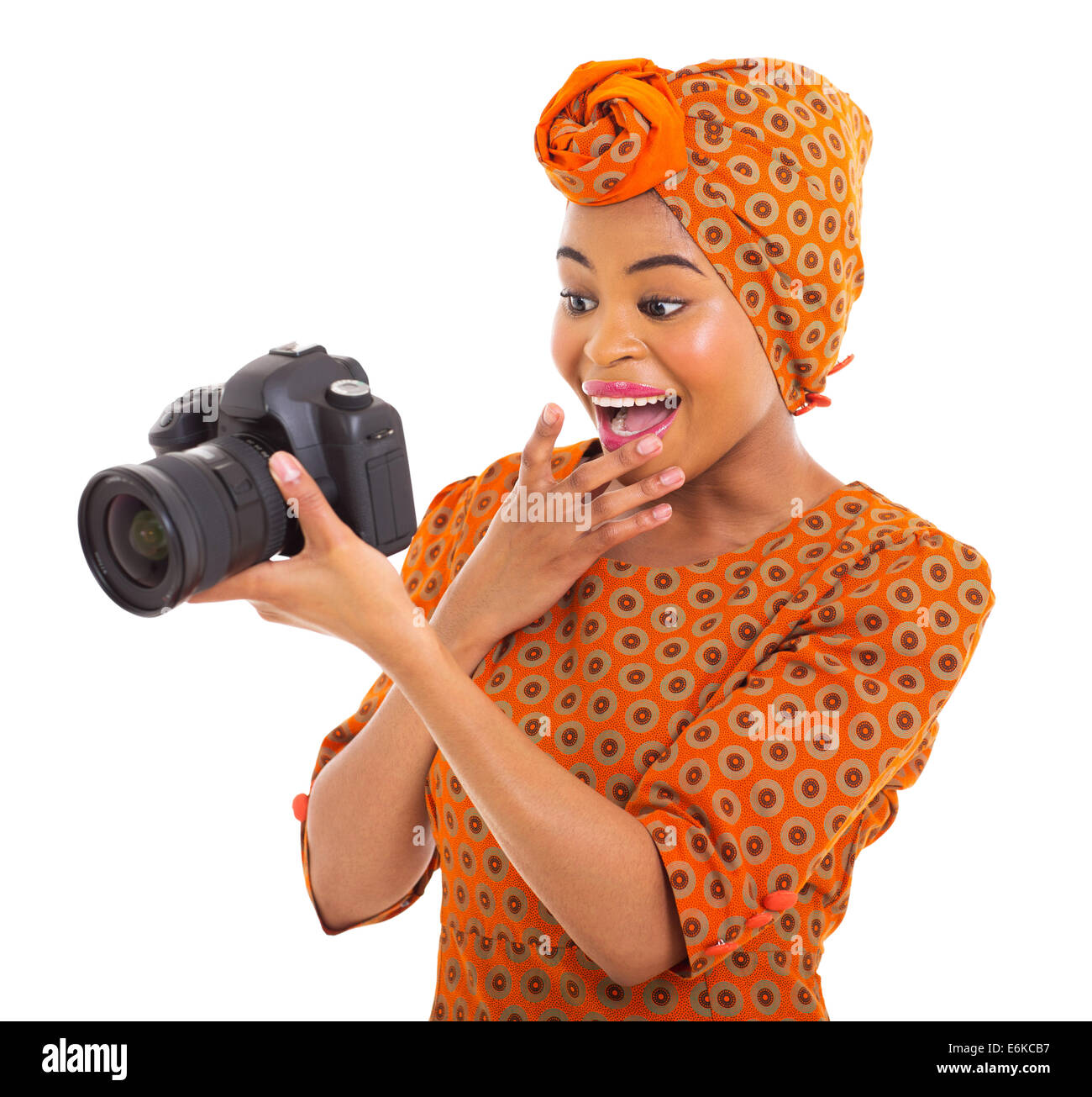 surprised African woman viewing pictures on camera on white background - Stock Image