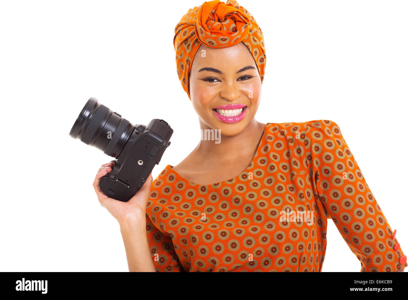 pretty African woman holding a digital SLR camera isolated on white - Stock Image