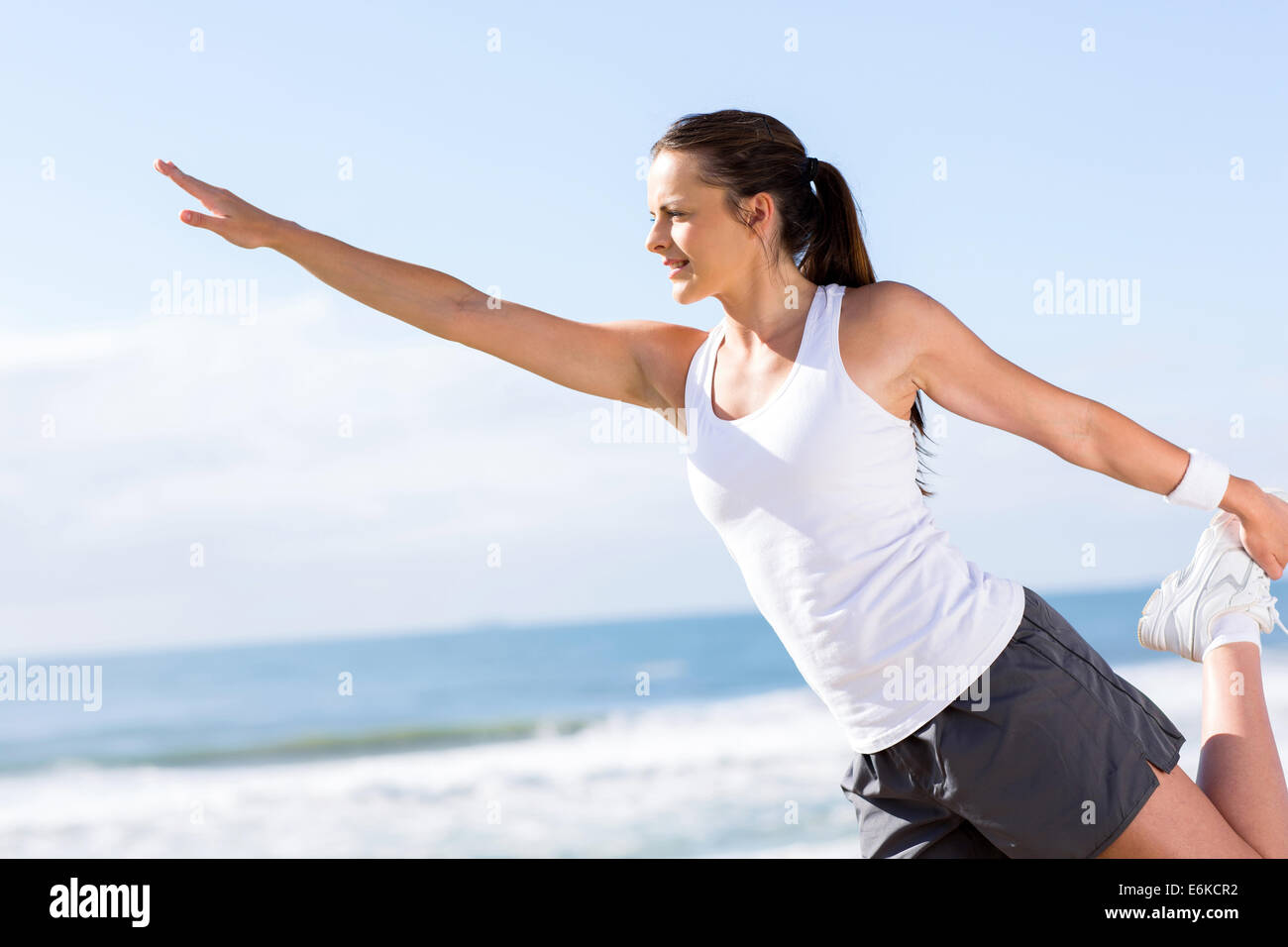 healthy woman working out at the beach - Stock Image