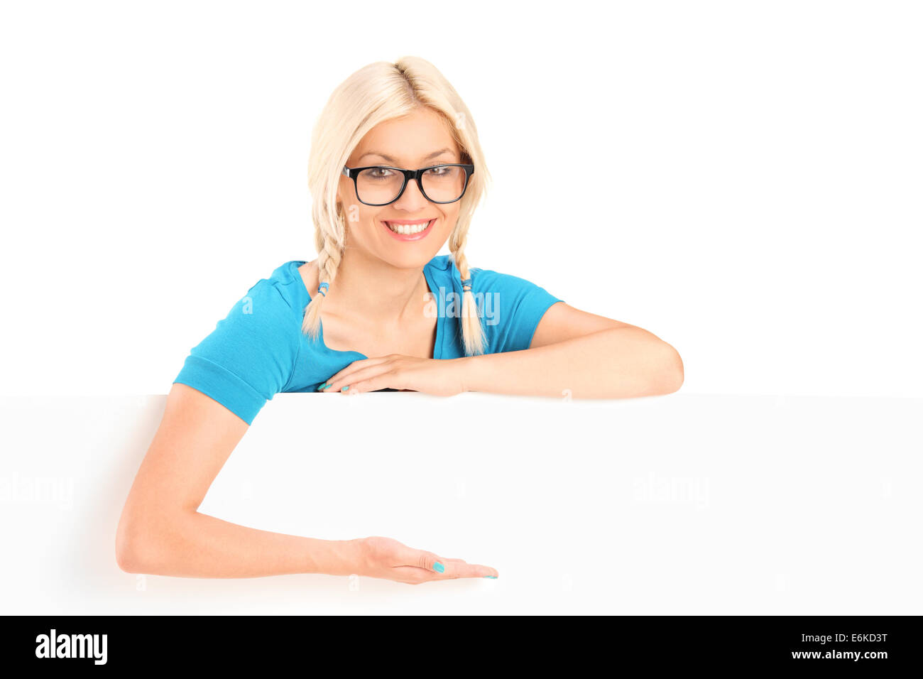 Blond woman gesturing with hand behind a panel - Stock Image