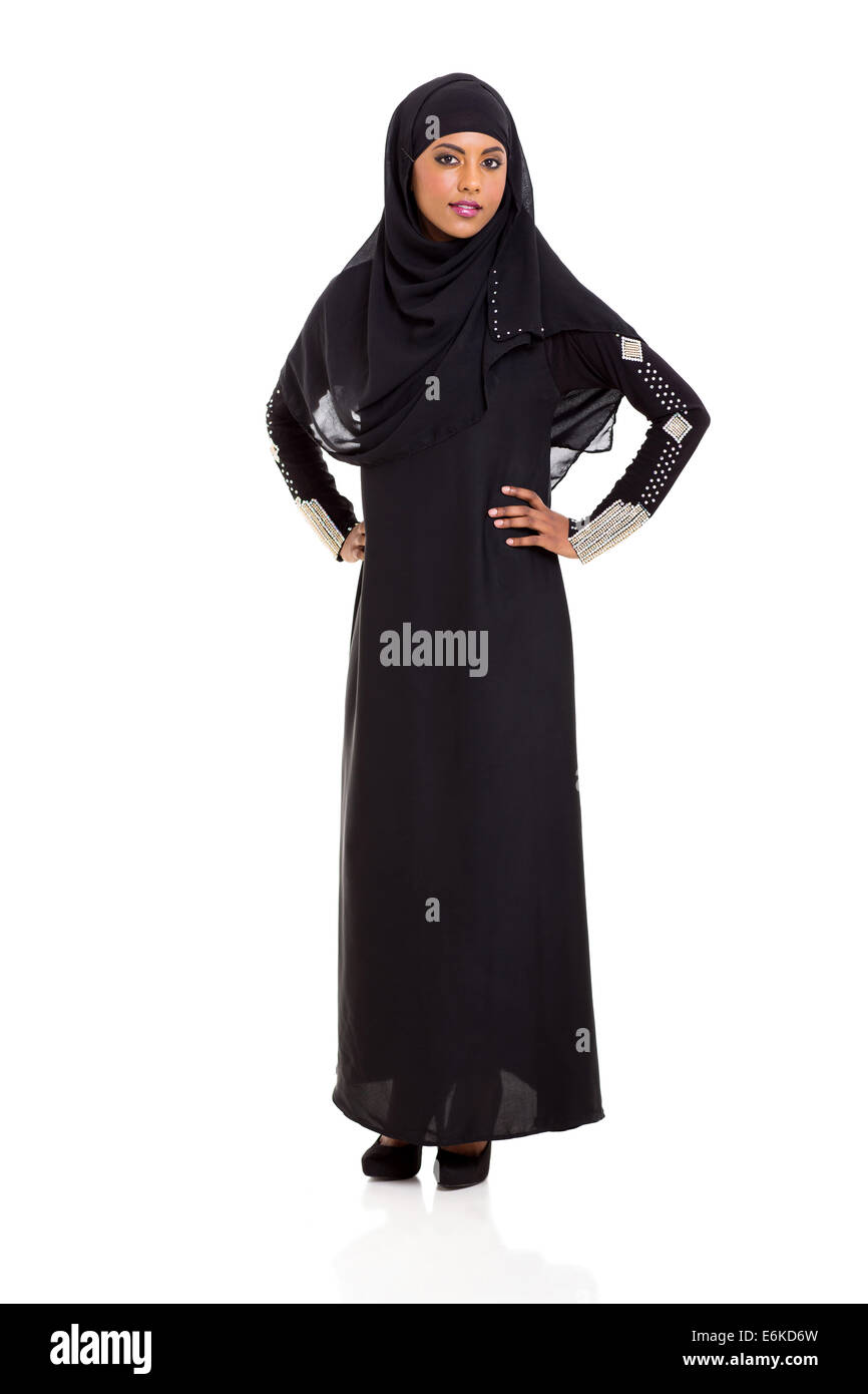 attractive young Muslim woman standing on white background - Stock Image