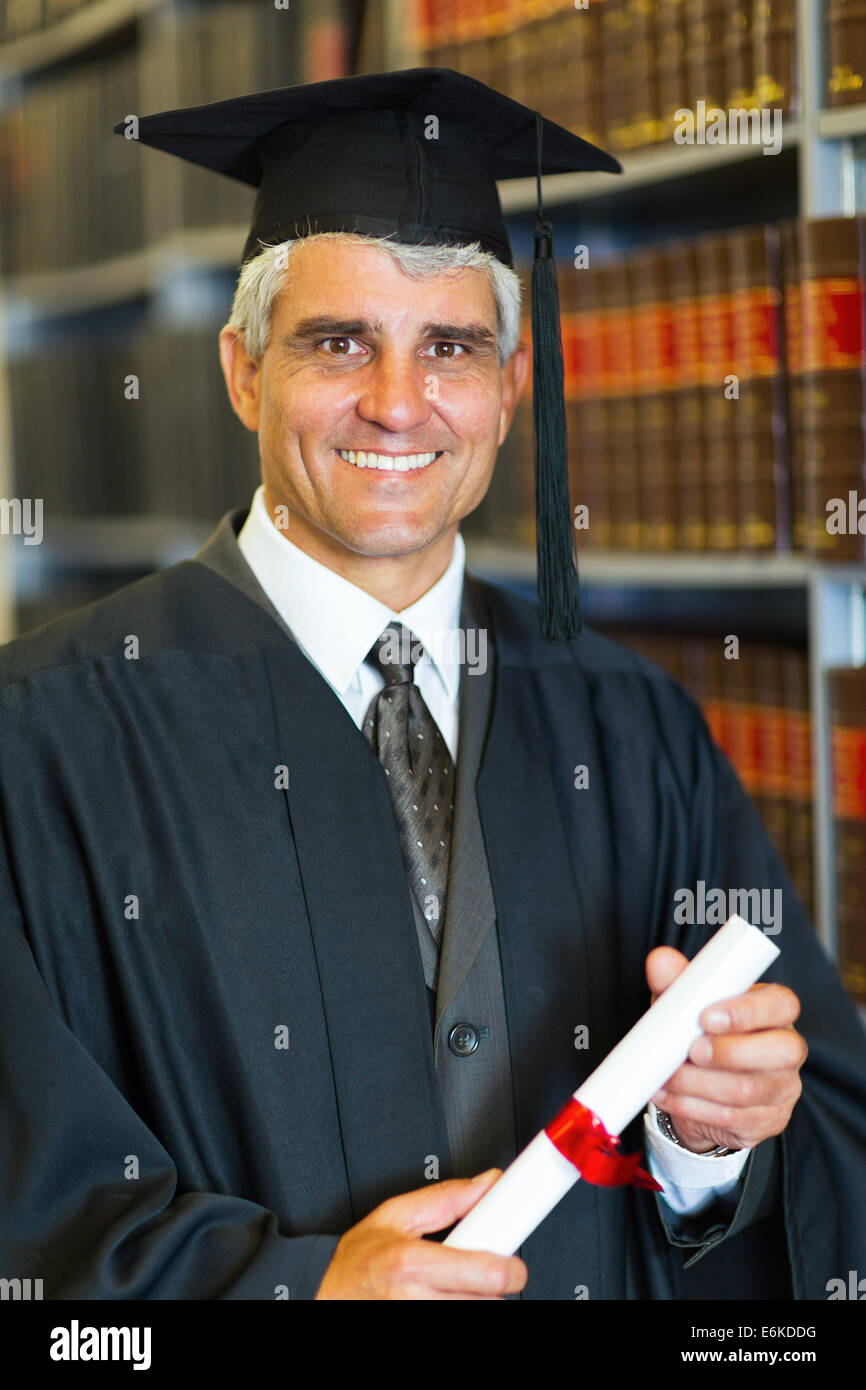 cheerful mid age male law school graduate holding diploma - Stock Image