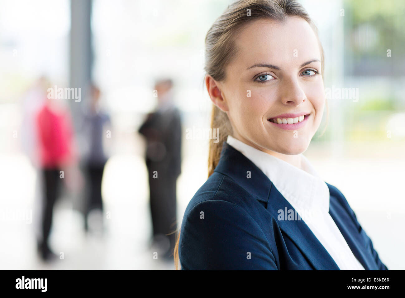 pretty young business woman in modern office - Stock Image