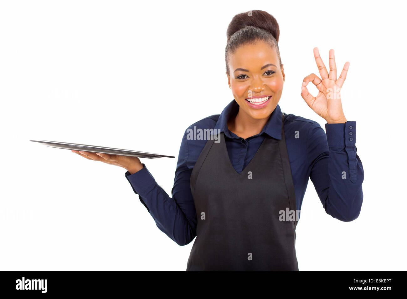 cute young African American waitress giving ok hand sign isolated on white - Stock Image