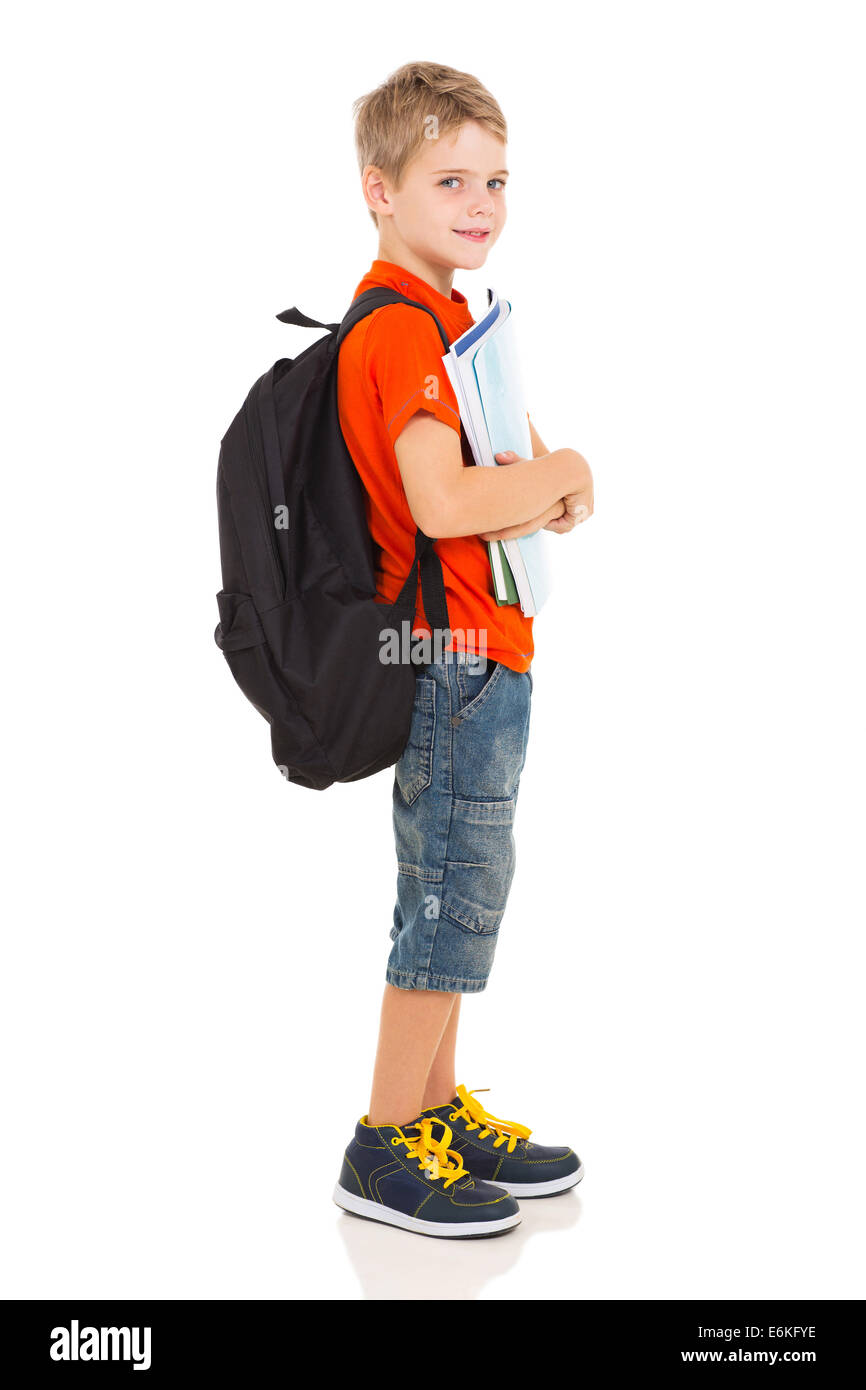 side view of male elementary school student with backpack - Stock Image