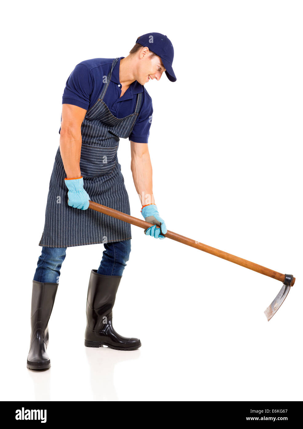 gardener working with a hoe isolated on white background - Stock Image