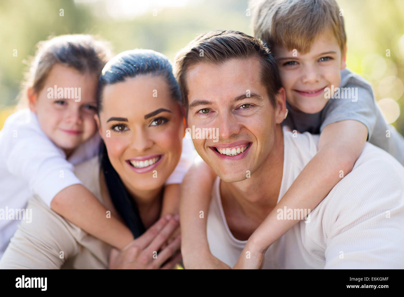loving young family having fun together outdoors Stock Photo