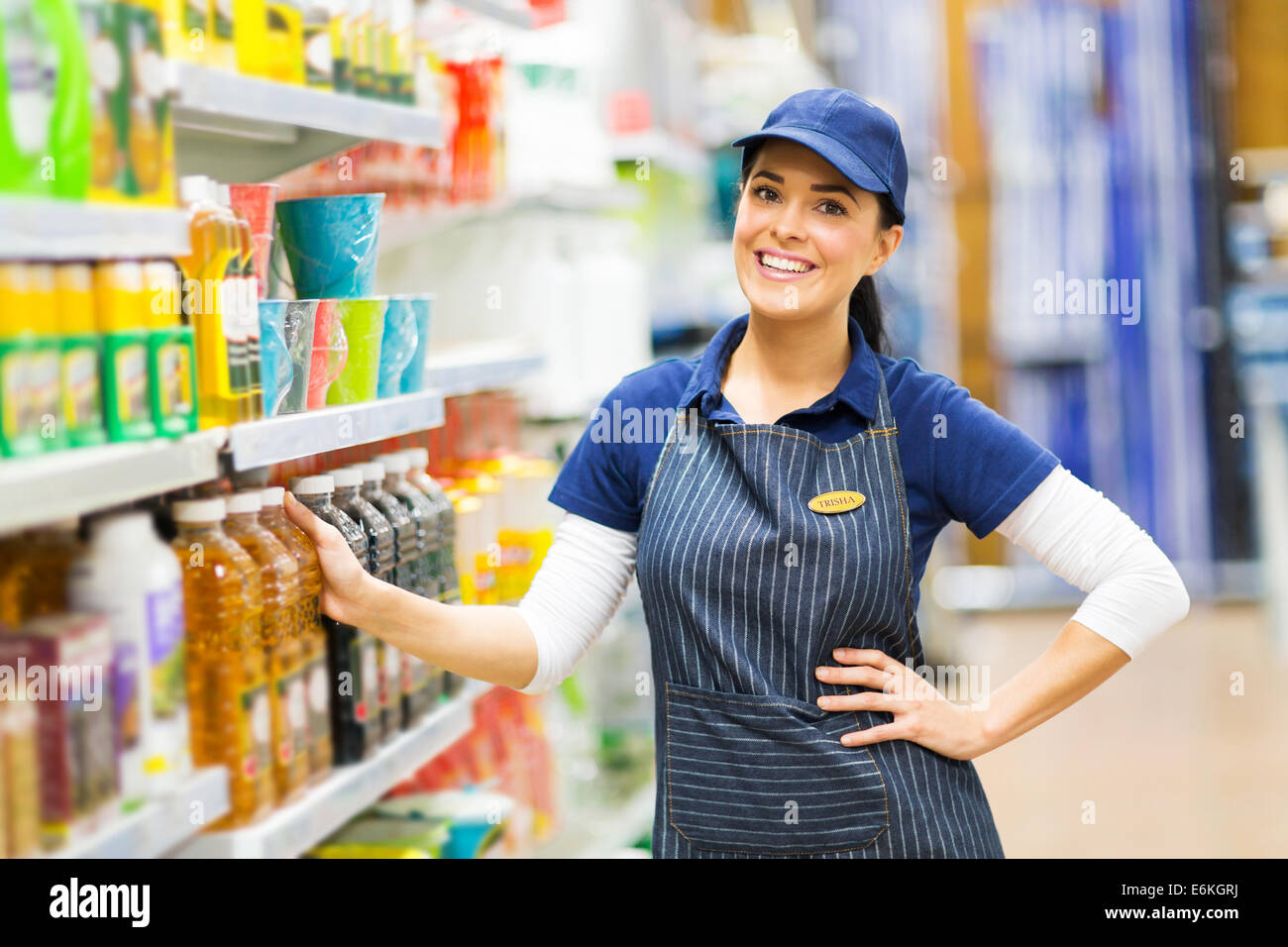 beautiful supermarket saleswoman standing in store - Stock Image