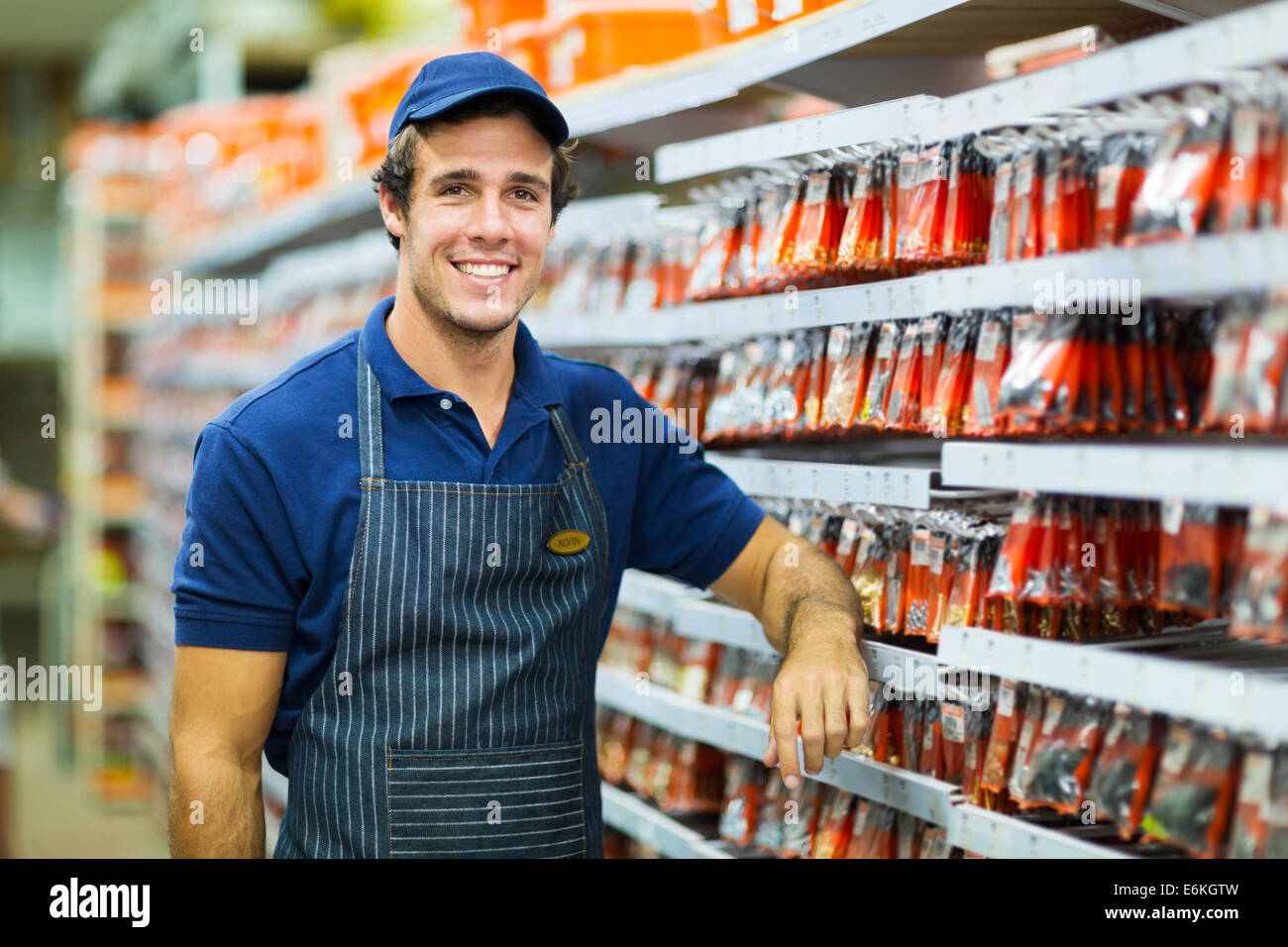 happy hardware store worker looking at the camera - Stock Image
