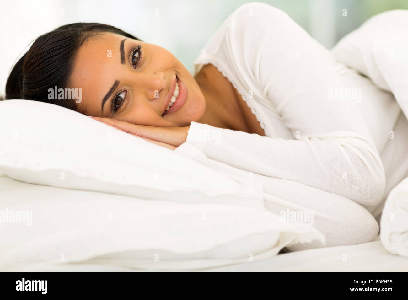 gorgeous girl lying in comfy bed - Stock Image
