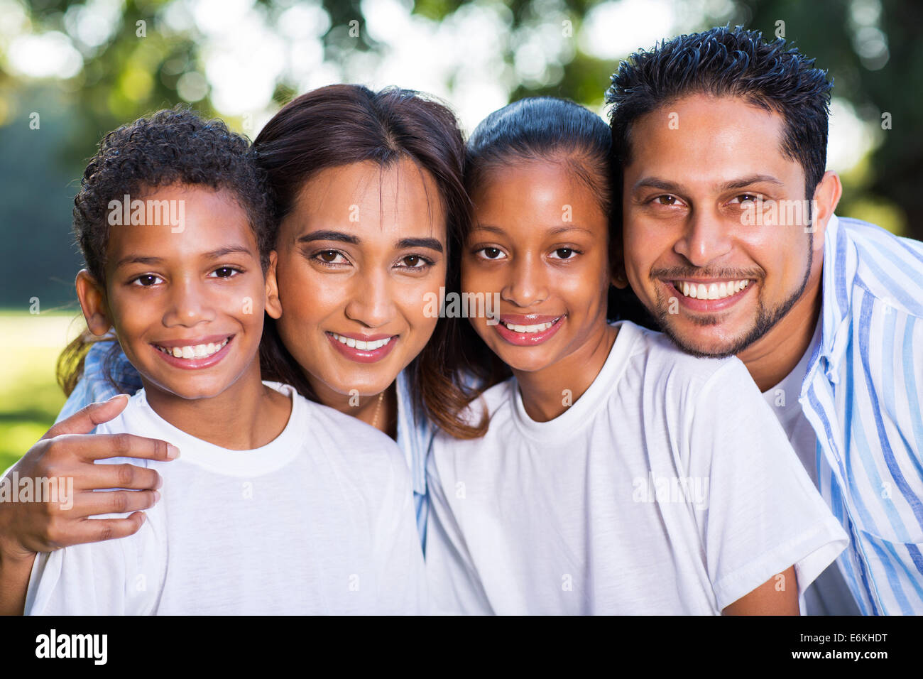 beautiful young Indian family portrait outdoors - Stock Image