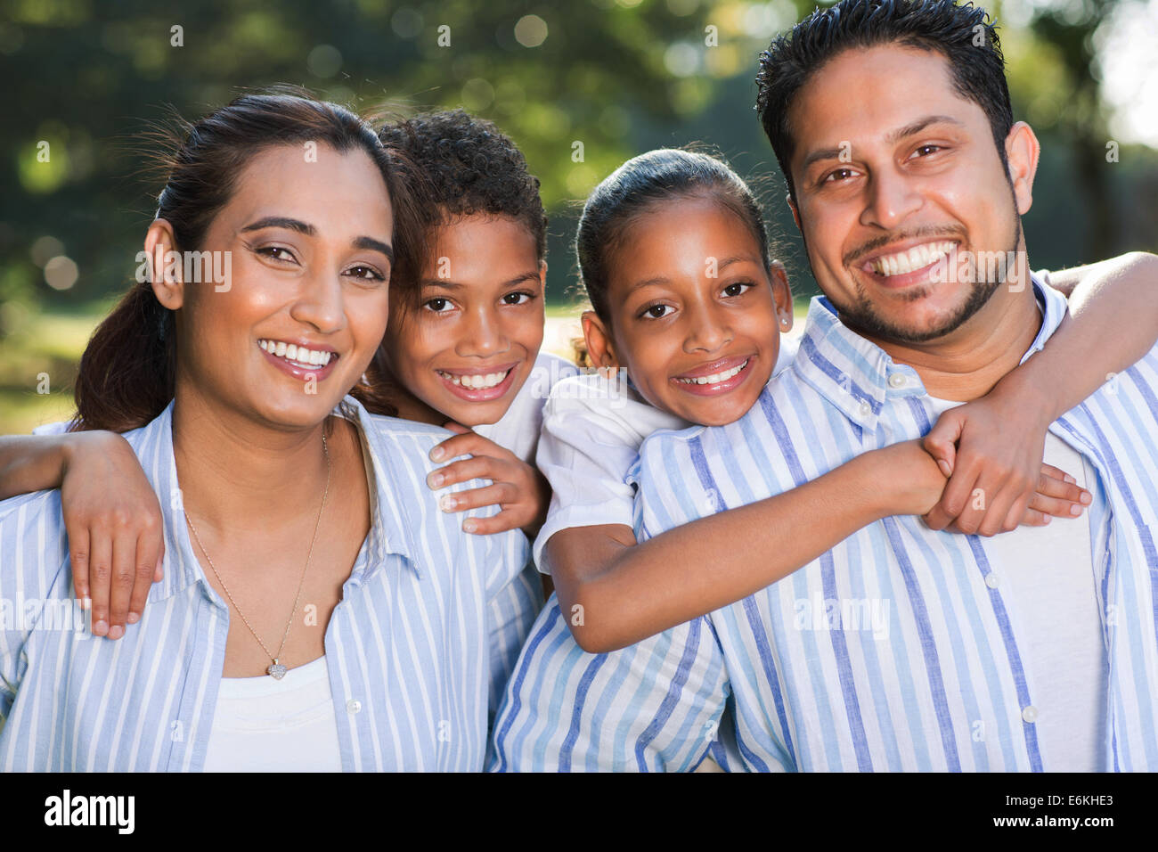 portrait of Indian family having fun together outdoors - Stock Image