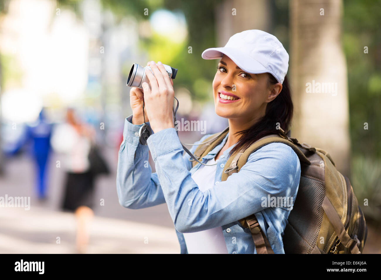 cheerful young tourist photographing in town Stock Photo