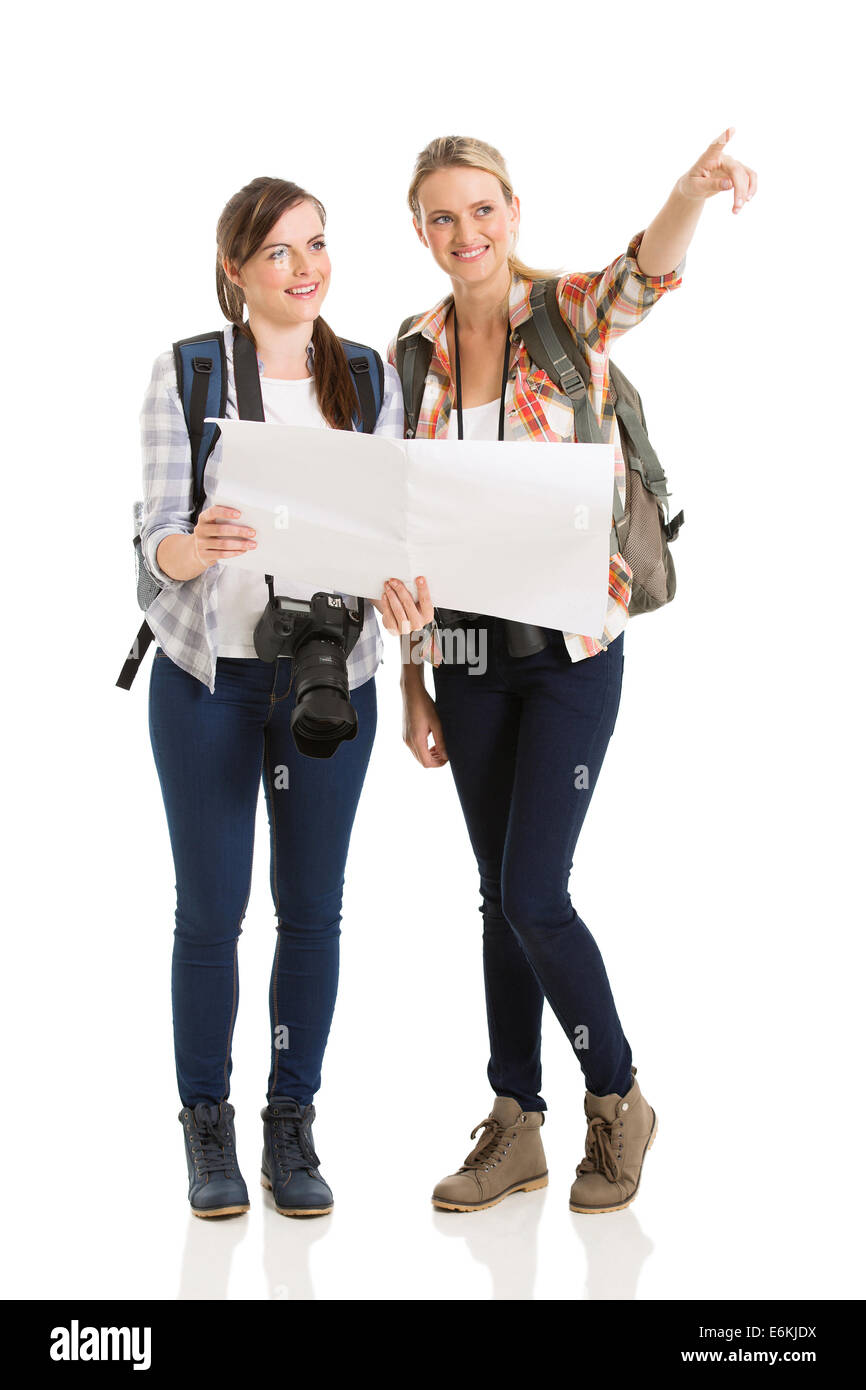 happy two female tourists sightseeing with map - Stock Image