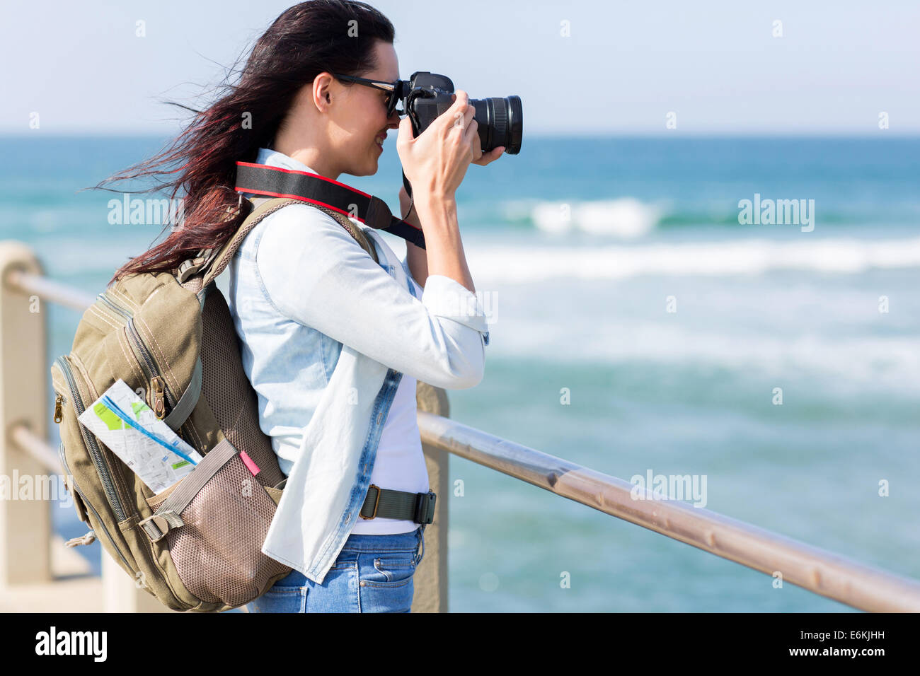 happy young tourist photographing at beach Stock Photo
