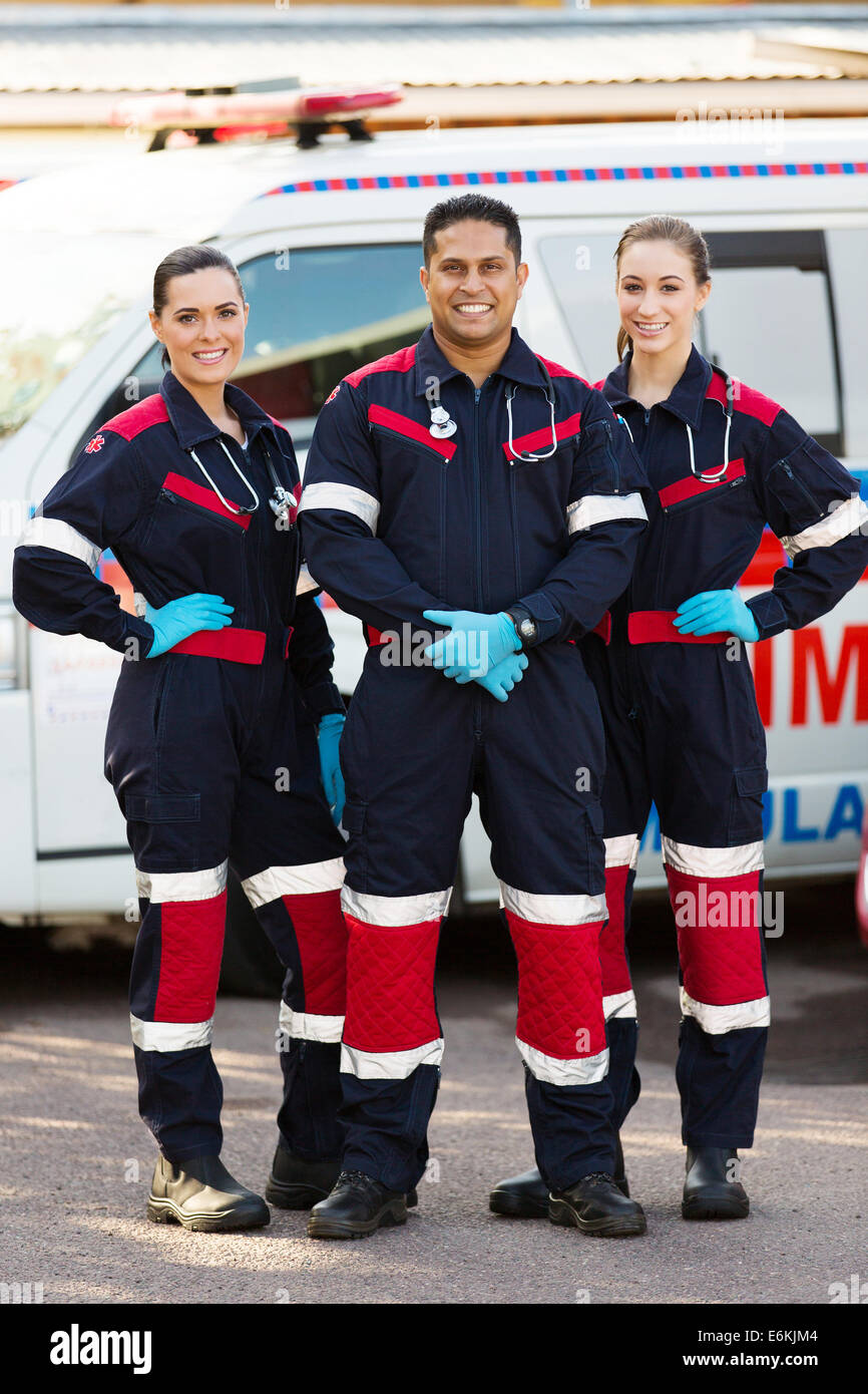 group of emergency medical service team in front of ambulance - Stock Image