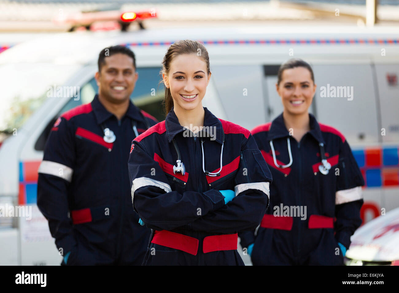 group of emergency medical technicians in front of ambulance Stock Photo
