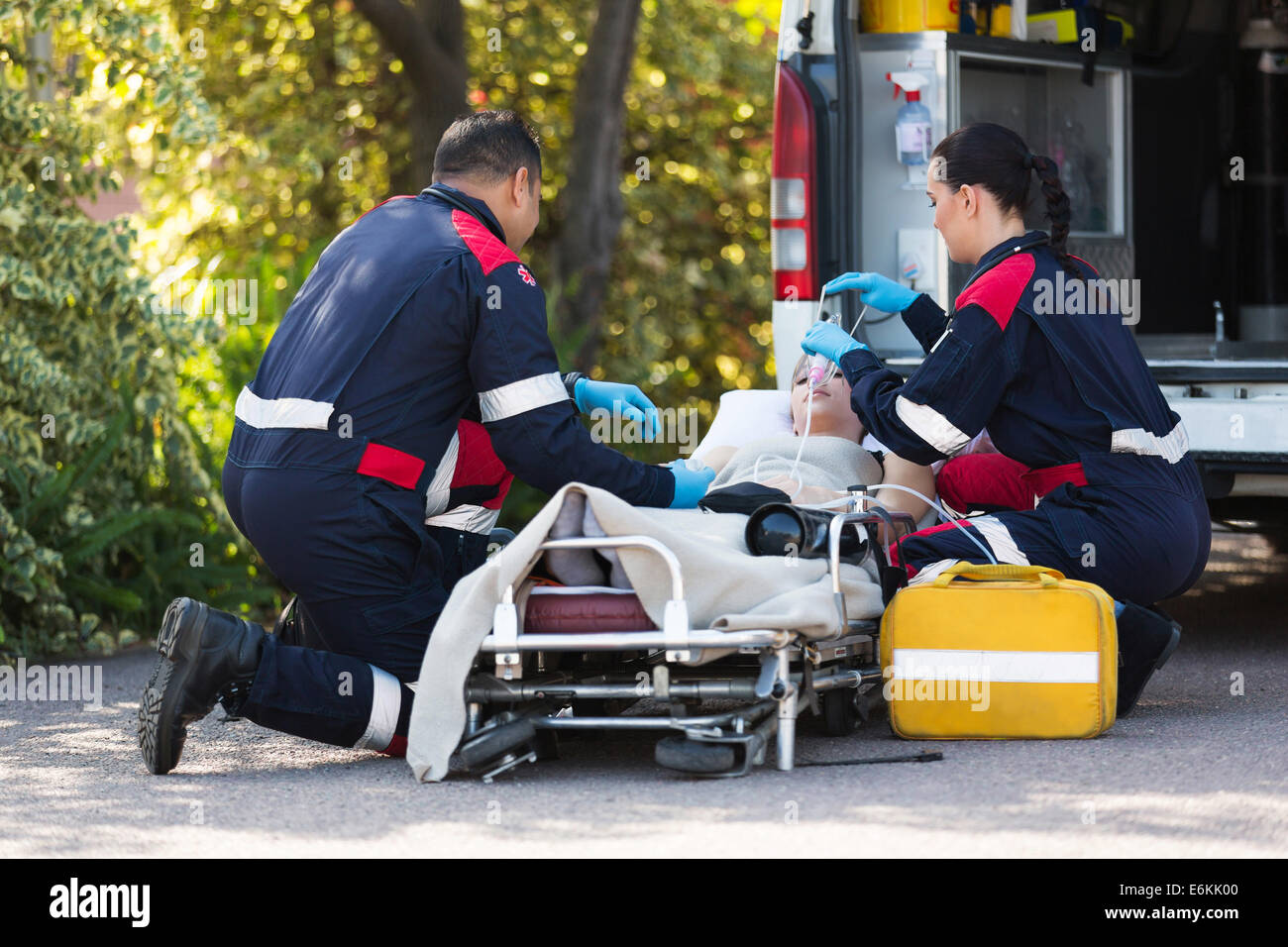 team of emergency medical staff rescuing patient Stock Photo