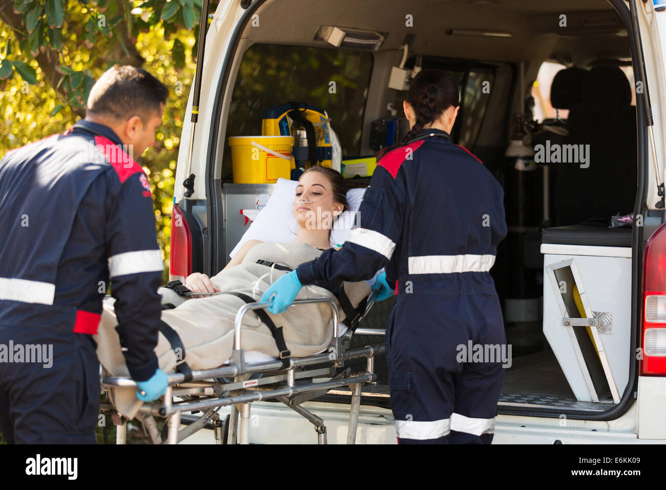 paramedics transporting patient to hospital with ambulance Stock Photo