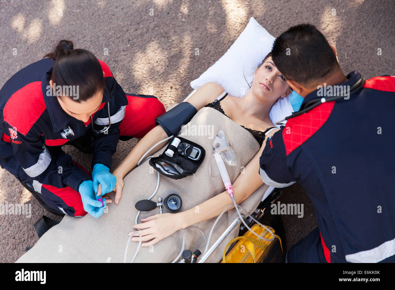 above view of paramedic team examining patient Stock Photo