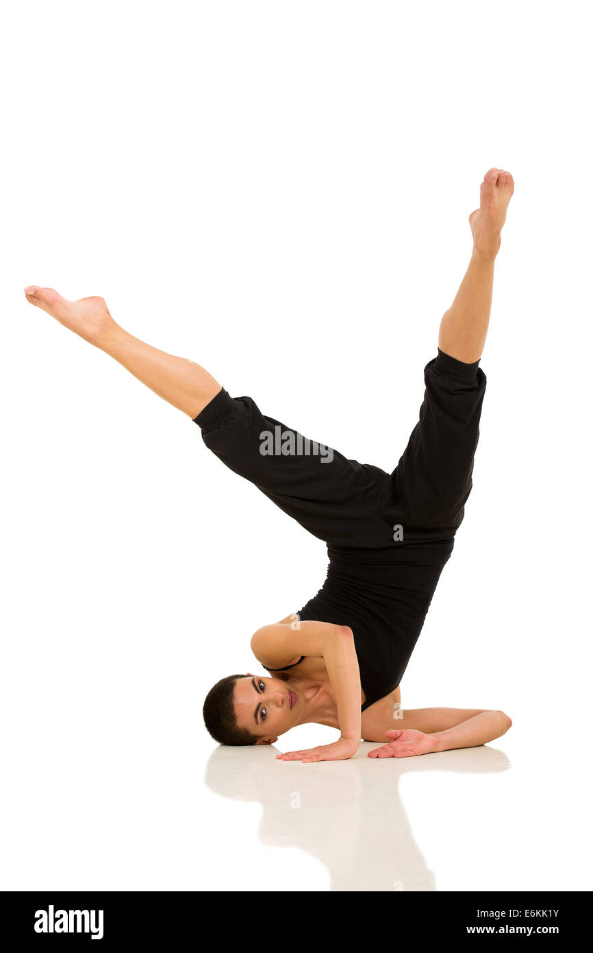 healthy young dancer posing on white background - Stock Image