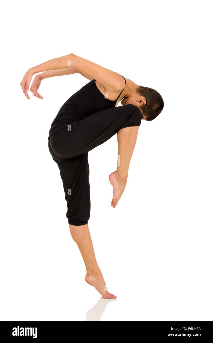 professional female dancer practicing in studio - Stock Image