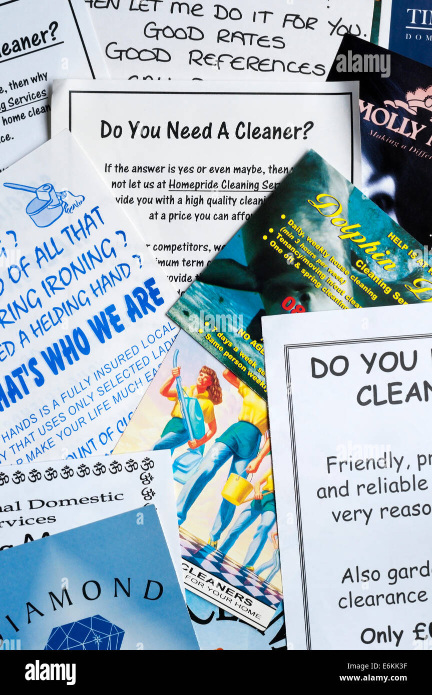 Junk mail leaflets delivered door to door from small one-woman or one-man businesses seeking domestic cleaning work. - Stock Image