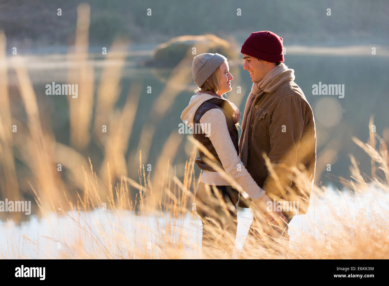 romantic couple flirting near lake - Stock Image