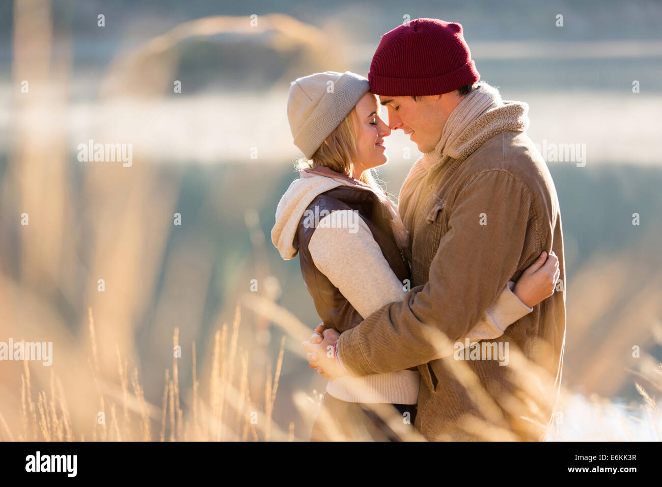loving young couple in autumn morning by the river - Stock Image