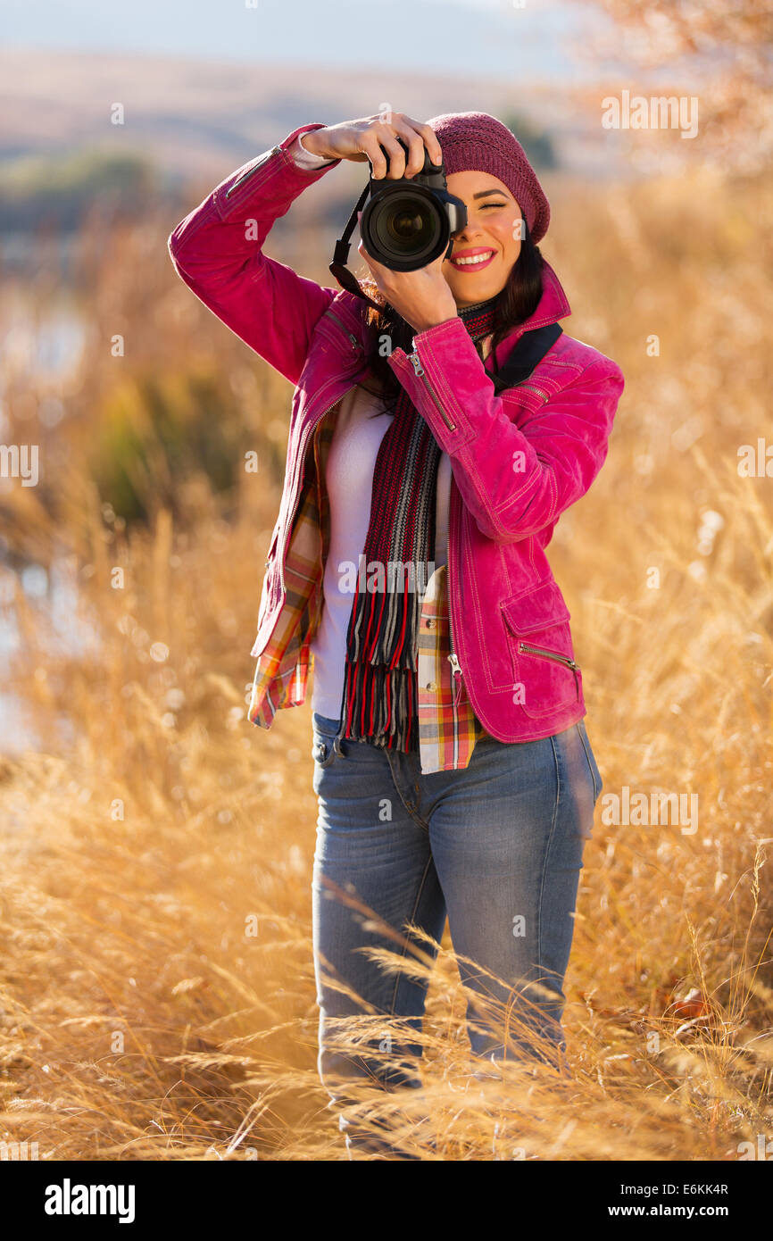 pretty woman taking photos of winter wildness - Stock Image