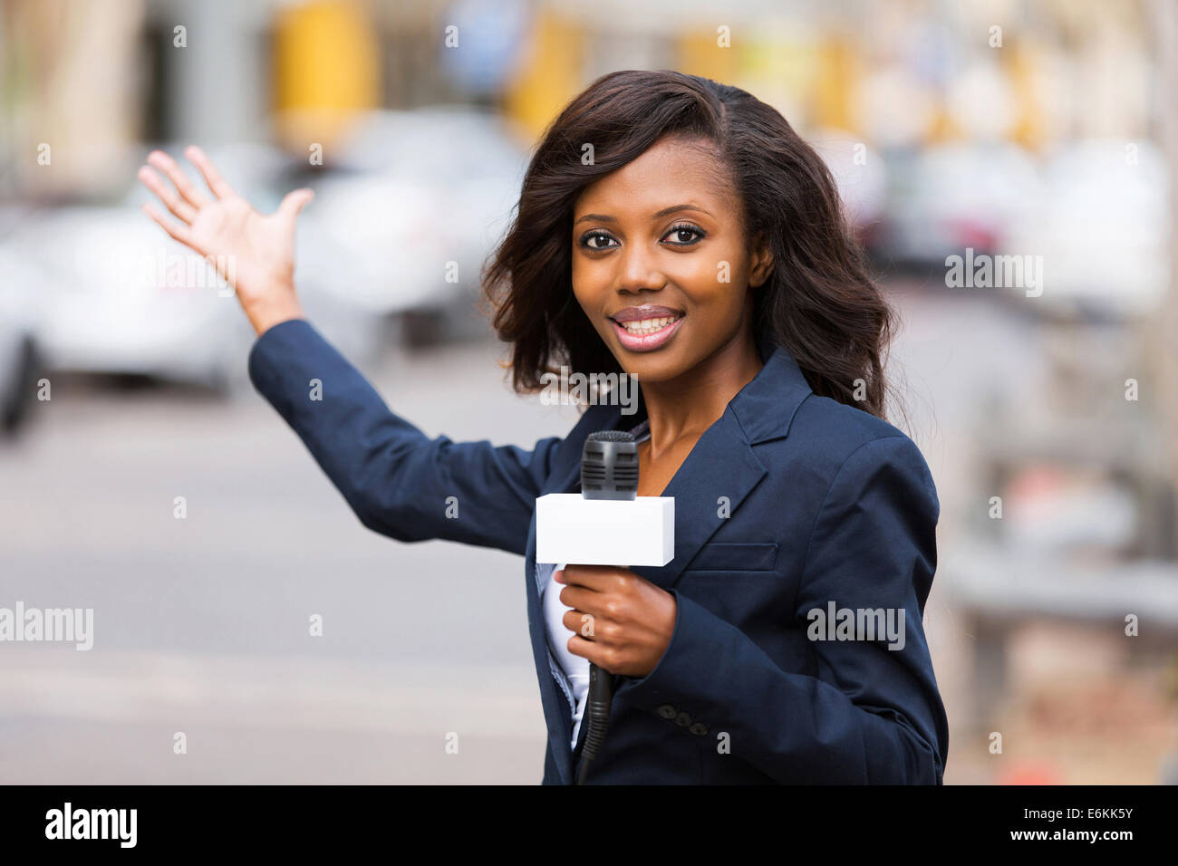 professional African news reporter in live broadcasting on street - Stock Image