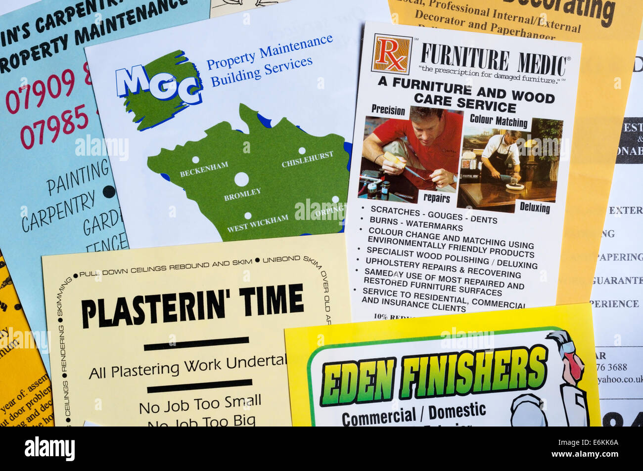 Junk mail leaflets delivered door to door from small or one-man businesses seeking painting and decorating or building - Stock Image