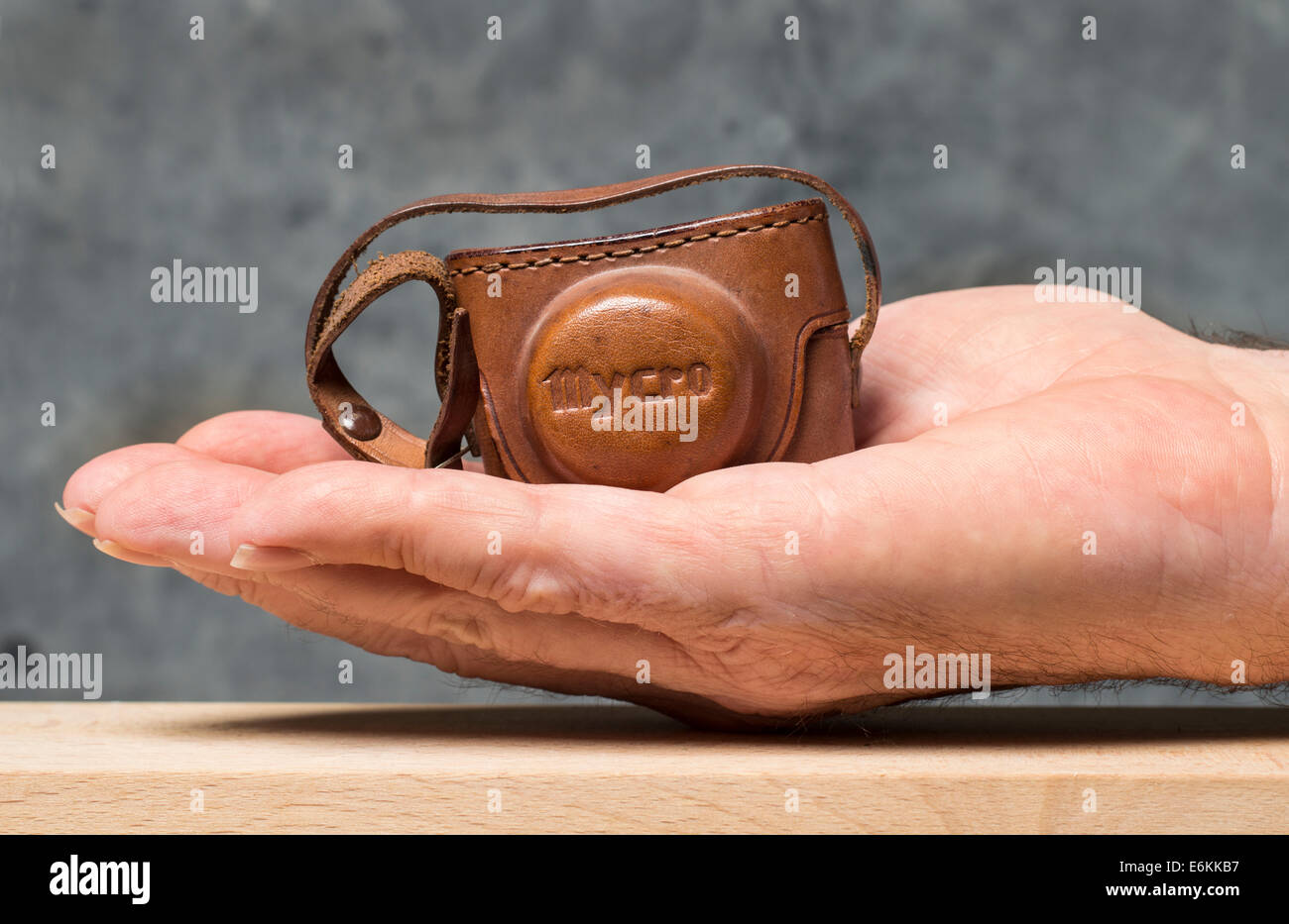 Mycro subminiature sub miniature camera in it's case on a man's hand - Stock Image