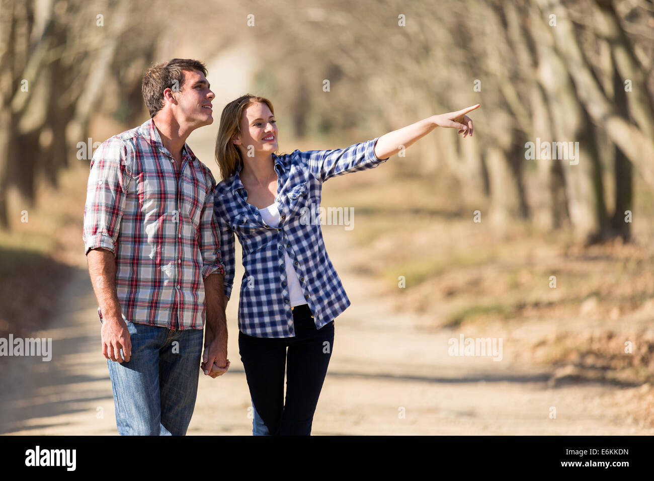 happy couple bird watching outdoors in fall - Stock Image
