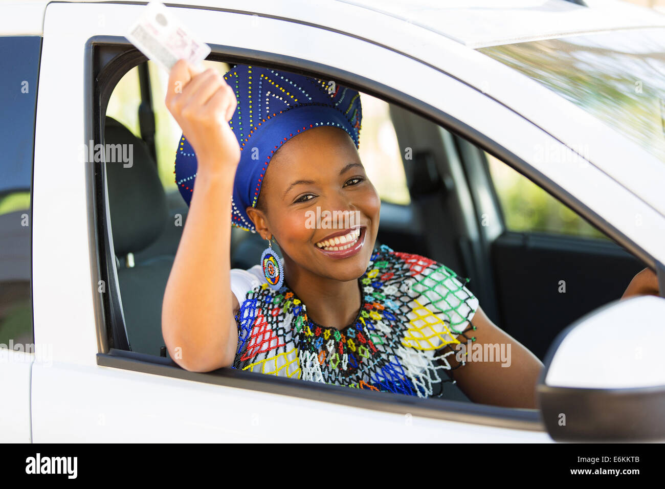 cheerful African woman holding her driving license Stock Photo