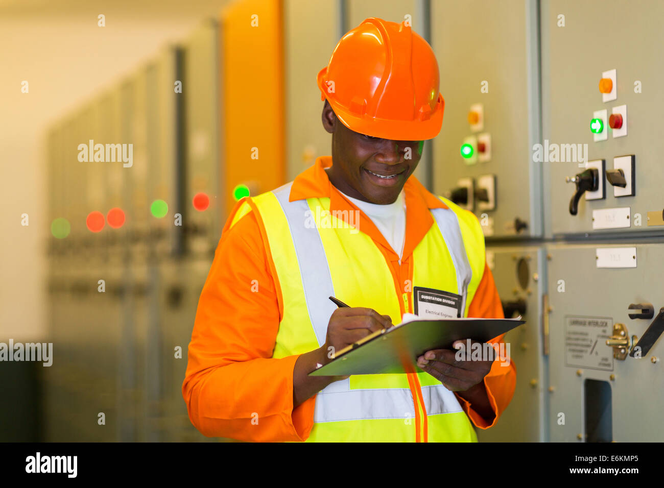 African electrical engineer in substation control room - Stock Image