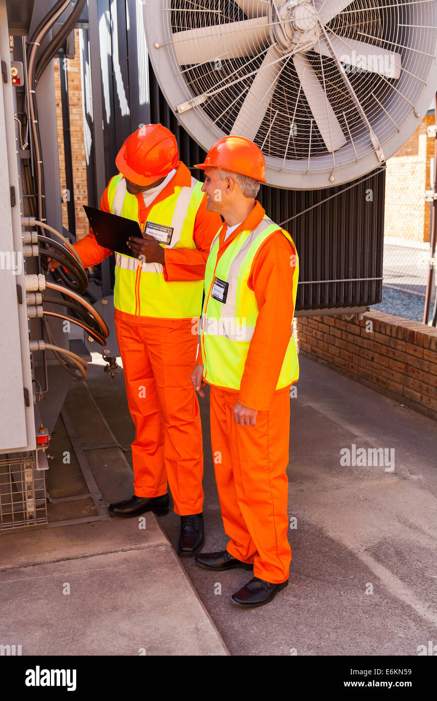 Transformer Wiring Stock Photos Images Two Transformers In Series Technicians Discussing Substation Image