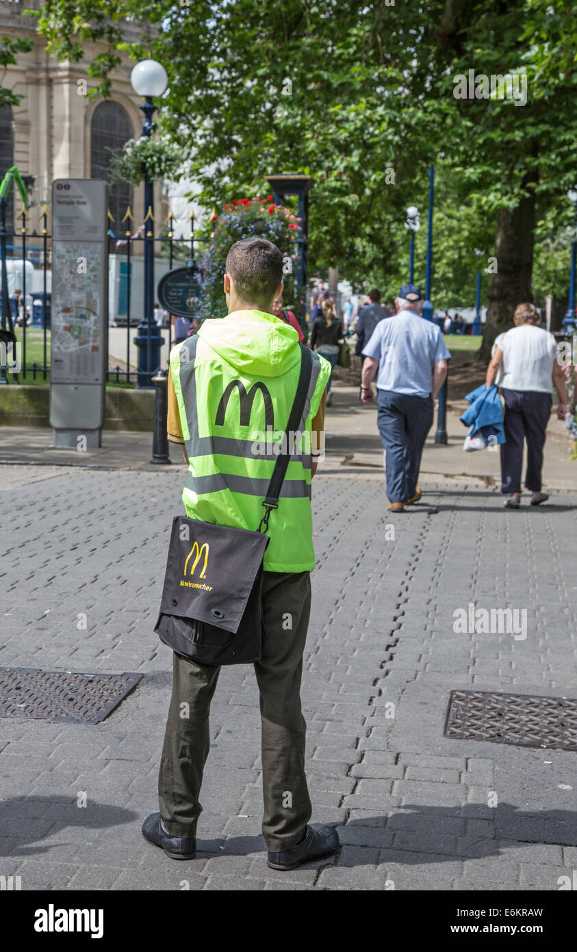 McDonald's staff handing out promotional leaflets, England, UK - Stock Image