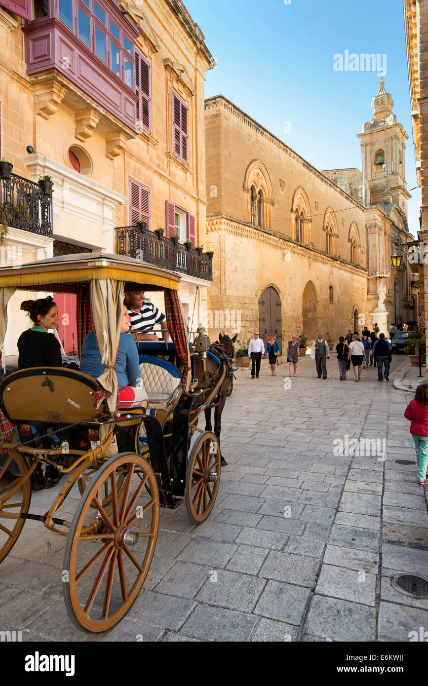 Tourists on horse and cart, Mdina, Malta, - Stock Image