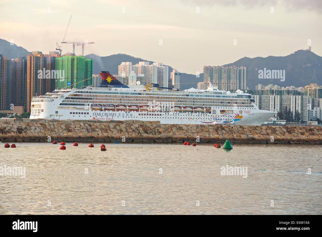 Cruise Ship Steaming Through Victoria Harbour. Causeway Bay, Hong Kong. Stock Photo