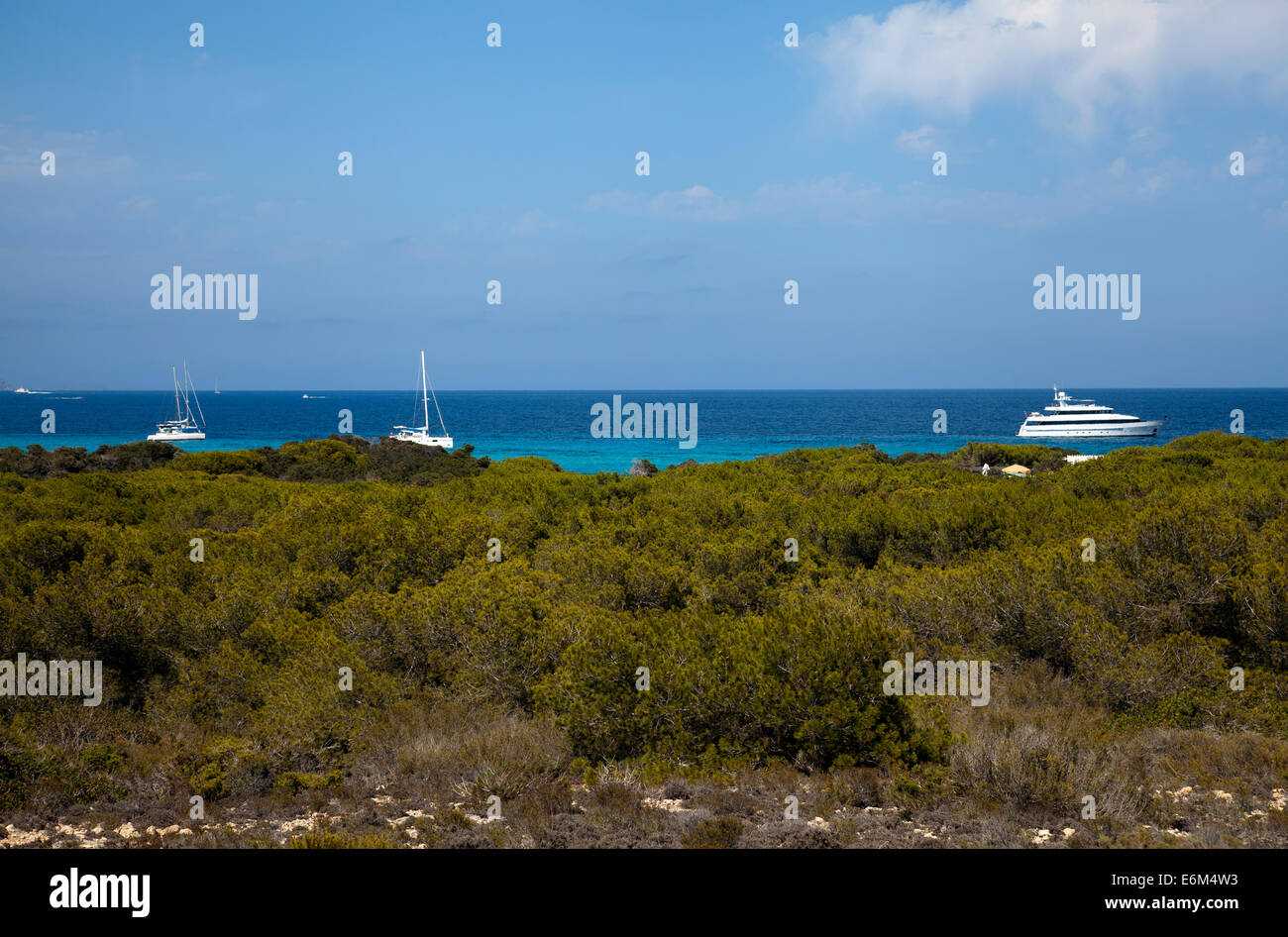 Moored Yachts Offshore at Es Cavallet in Ibiza - Stock Image