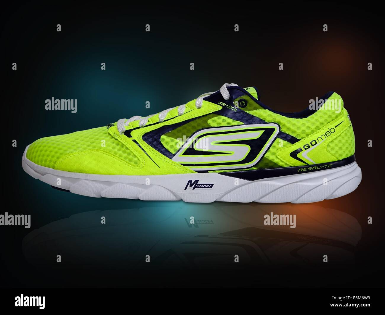 running shoe luminous bright yellow shoe - Stock Image