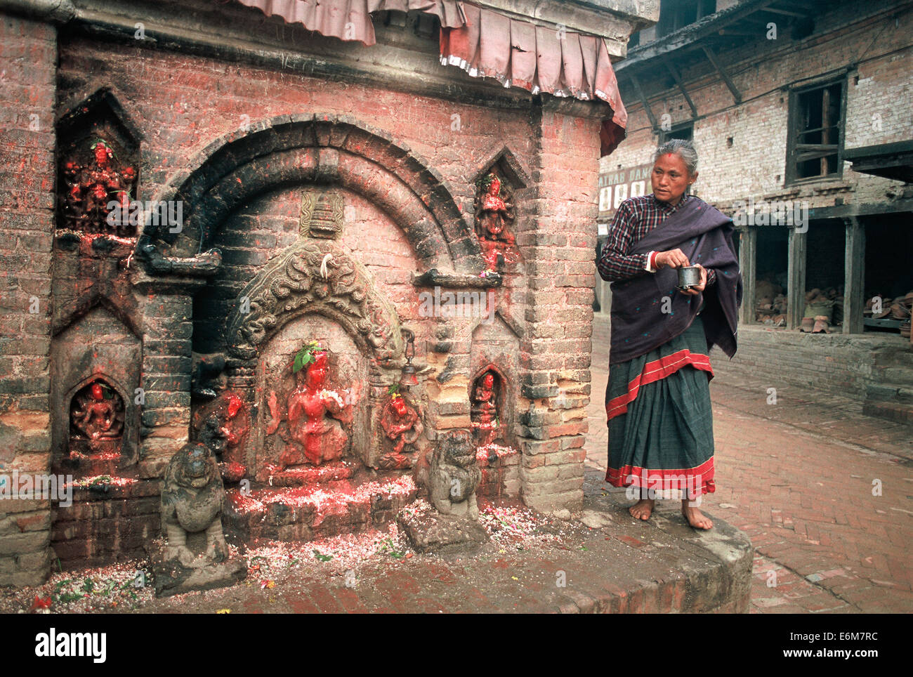 Newar woman worshipping a hindu deity ( Nepal) - Stock Image