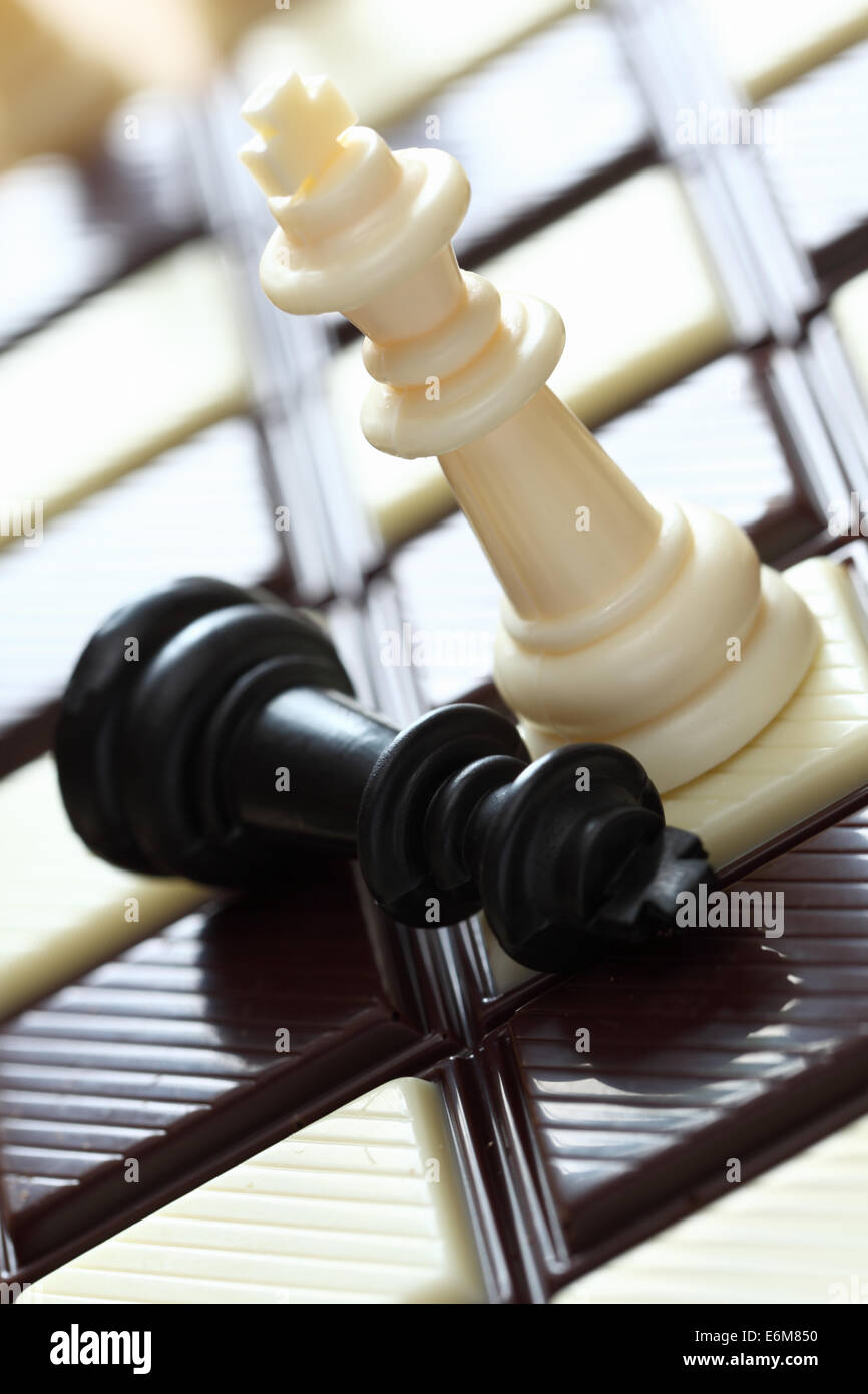 Defeat. Chess on the chocolate chessboard. Closeup. - Stock Image