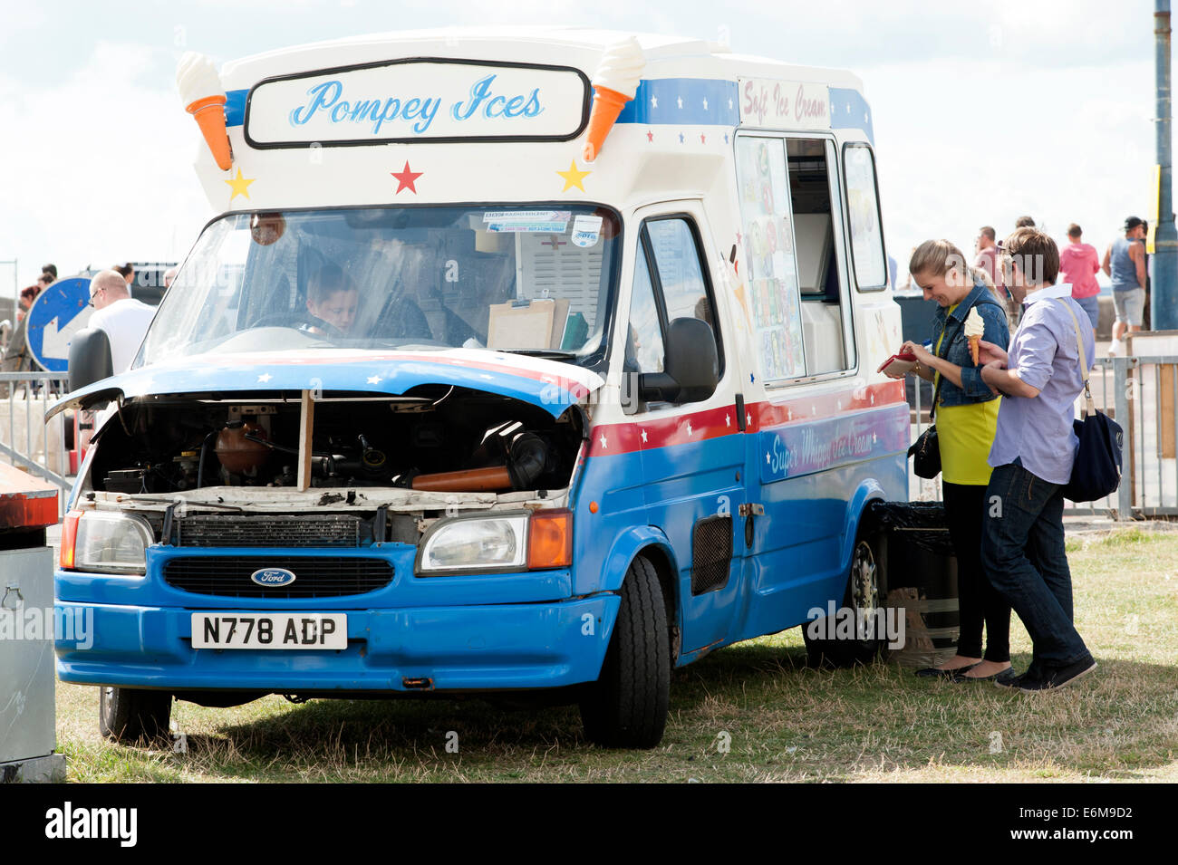 an ice cream van proves popular and does brisk business at the victorious festival 2014 southsea england uk - Stock Image
