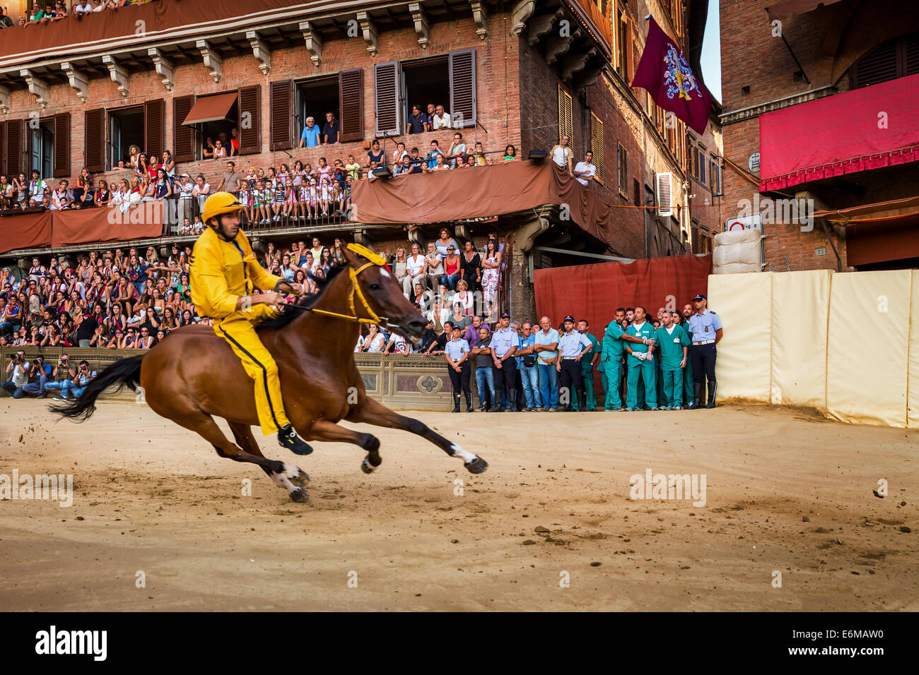 The Palio di Siena horse race on Piazza del Campo, Siena, Tuscany, Italy - Stock Image